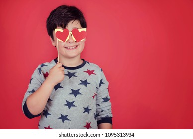 smiling boy with hearts in his eyes