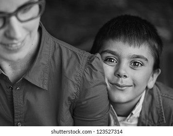 Smiling boy with his mom