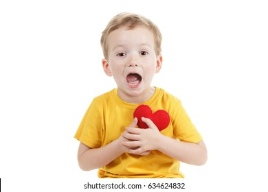 Smiling boy holding a red heart figurine. symbol of love, family, hope. Concept preservation of the family and children. Isolated white.