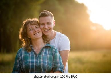 Smiling boy hugging his beloved mother