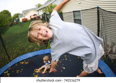 Smiling boy jumping on a trampoline