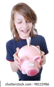 smiling boy with piggy bank