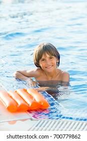 smiling boy playing in swimming pool