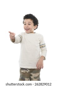 Smiling Boy Pointing at Something Isolated on A White Background