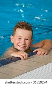 Smiling boy in a pool