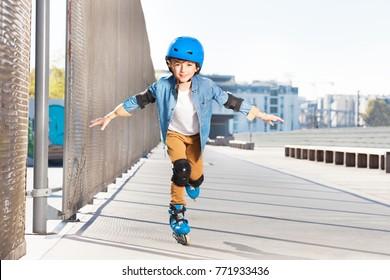Smiling boy practicing rollerskating at rink