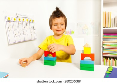 Smiling boy replicating example with color blocks