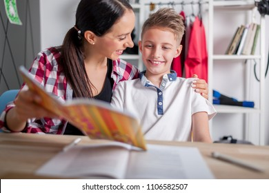 Smiling boy showing to his proud mother perfect test results or good grade for homework
