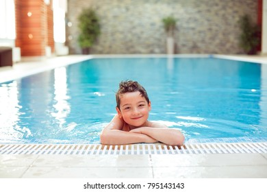 Smiling boy swimming in the pool