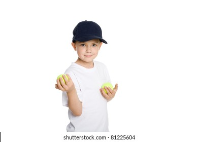 Smiling boy with tennis balls. Isolated on white.