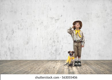 Smiling boy in uniform with dog