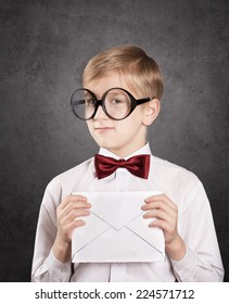 Smiling boy with the white envelope. Retro style portrait