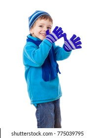 Smiling boy in winter clothes with long nose sign, isolated on white
