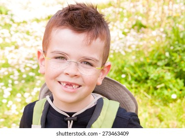 Smiling boy without front teeth, outdoors
