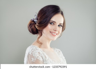 Smiling bride with makeup and updo hair bridal hairstyle