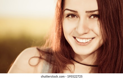 smiling brunet portrait outdoor