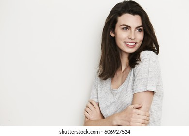Smiling brunette looking away, studio