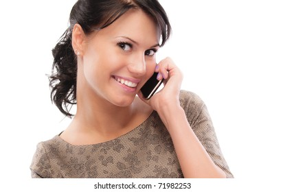 Smiling brunette speaks by mobile phone, isolated on white background.