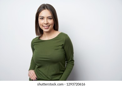 Smiling brunette woman standing looking at camera