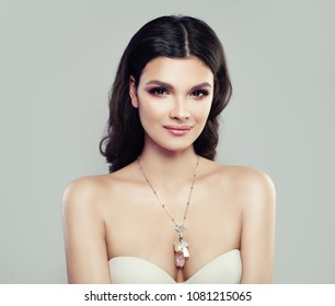 Smiling Brunette Woman Wearing Jewelry Necklace with Pendant