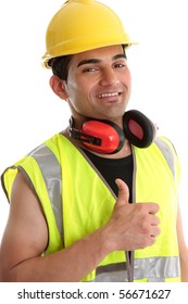 Smiling builder, construction worker or other trades man showing a  thumbs up sign. White background.