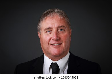 Smiling Buisnessman wearing a suit