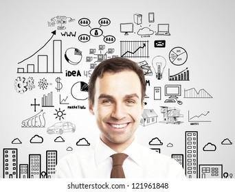 smiling businesman and business plan concept