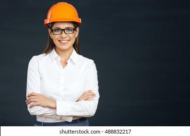 Smiling business builder woman portrait on black.