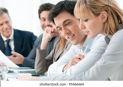 Smiling business colleagues working together during a meeting in office
