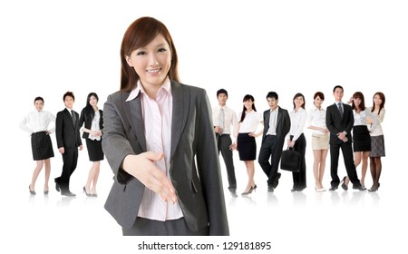 Smiling business executive woman of Asian make a handshake with you in front of her team isolated on white background.
