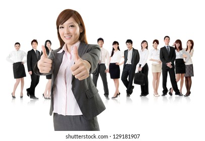 Smiling business executive woman of Asian give you an excellent sign in front of her team isolated on white background.