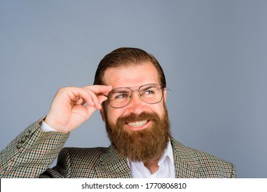 Smiling business man with glasses. Bearded man in formal suit. Portrait of businessman wearing glasses. Happy businessman in glasses.