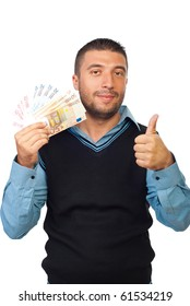 Smiling business man holding euro banknotes and giving thumb up isolated on white background