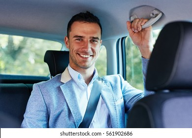 Smiling business man sitting in the car
