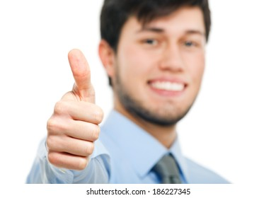 Smiling business man thumbs up isolated on white