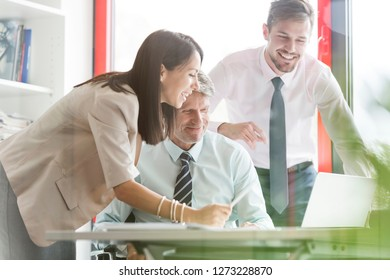 Smiling business people in meeting at office desk