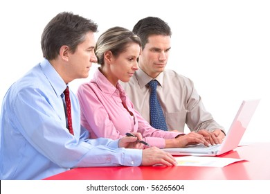 Smiling business people team working in the office with laptop