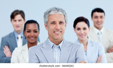 Smiling business team showing ethnic diversity against a white background