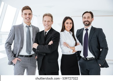 Smiling Business team standing in office and look at camera
