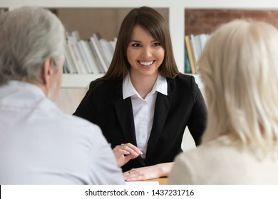 Smiling business woman bank manager or job applicant consulting old couple clients talking to hr during interview meeting, young saleswoman agent broker make insurance loan offer to senior customers