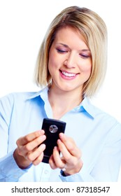 Smiling business woman with cell phone. Isolated over white background