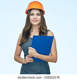 Smiling business woman with clipboard wearing protect helmet. Isolated portrait.