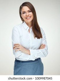 Smiling business woman with crossed arms. Portrait isolated on white background.