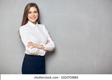 Smiling business woman with crossed arms. Confident successful girl.