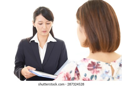 Smiling business woman with customer