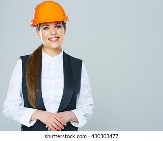 Smiling Business woman engineer isolated portrait with crossed arms.
