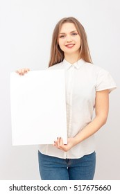 Smiling Business woman hold blank card.  woman holding paper blank. Portrait of emotional young woman showing surprised and happy emotions. studio portrait of beautiful girl. isolated portrait.