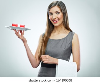 Smiling business woman hold red gift on a plate. Conceptual business portrait.
