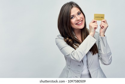 Smiling business woman holding credit card near face. isolated studio portrait.