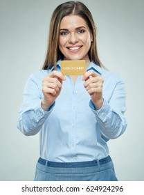 Smiling business woman holding credit card. Bank employee girl isolated portrait.